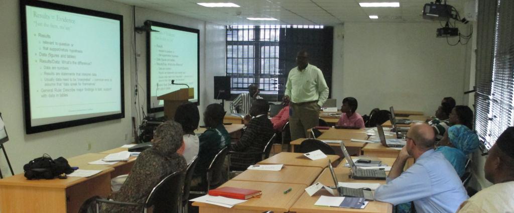 Course participants listen to Dr. Ndembi present